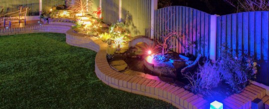 Water feature at night by Garden Pride